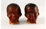 Pair of cruets formed as black children's heads